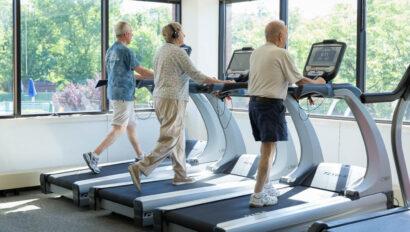 Seniors walking on treadmills.
