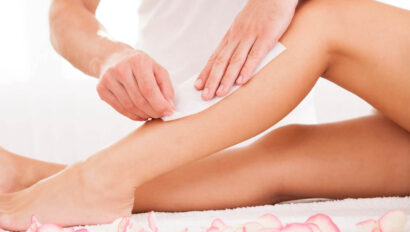 Woman getting legs waxed.