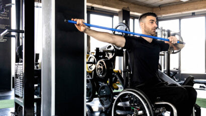 Man in wheel chair doing exercises.