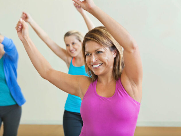 Women in a group dance exercise class.