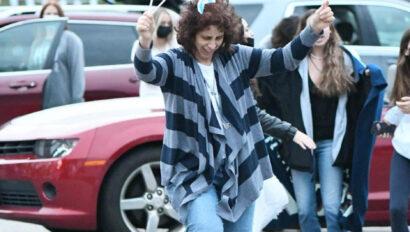 Woman waving Israeli flags.