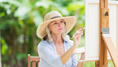 Woman painting outside.