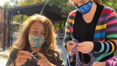 Two women knitting.