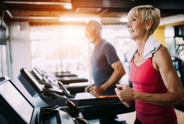 Image of attractive fit senior woman in gym.
