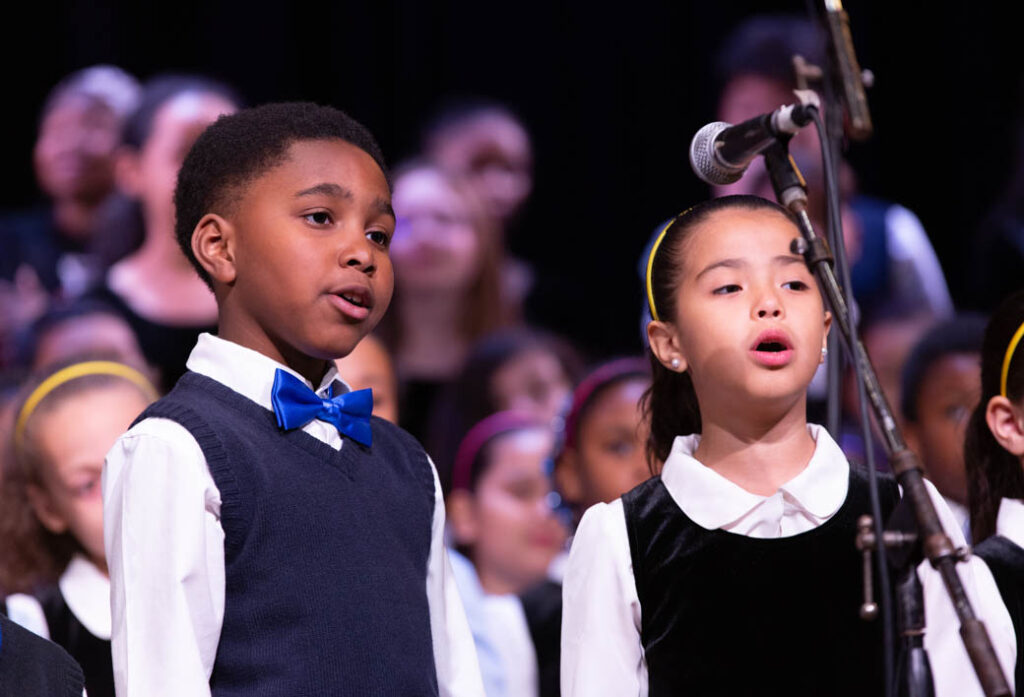 Two children doing a duet on stage.