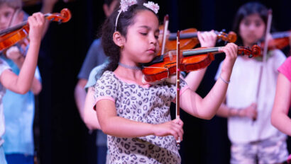 Girl playing the violin.