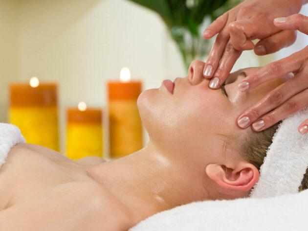 Woman getting a facial massage.