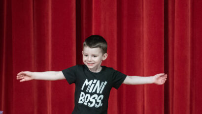 Young boy doing a hip hop performance on stage.