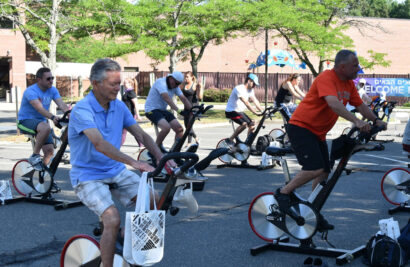 People riding on stationary bikes.
