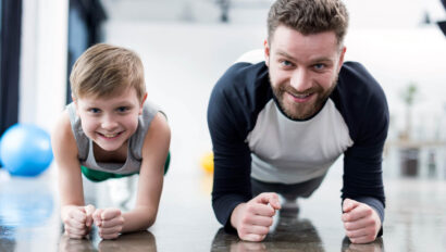 Man and boy doing low planks.